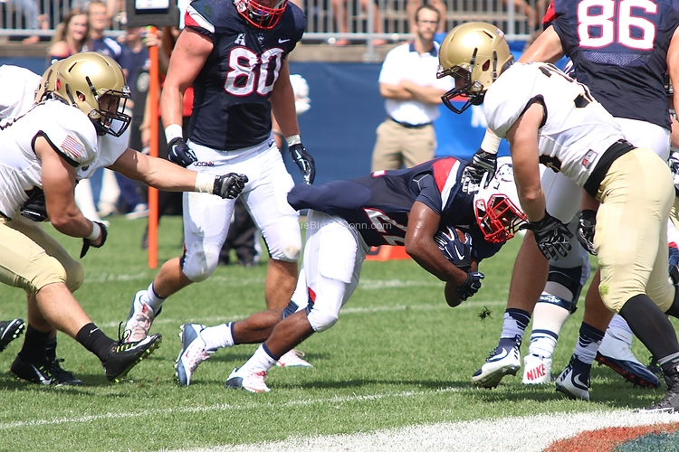 UConn's Arkeel Newsome (22) breaks free of an Army tackle for a touchdown during the UConn Huskies vs Army Black Knights football game at Pratt & Whitney Stadium at Rentschler Field in East Hartford, CT.